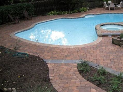 paver brick pool deck with brown concrete and pavers concrete paver pool decks the concrete network