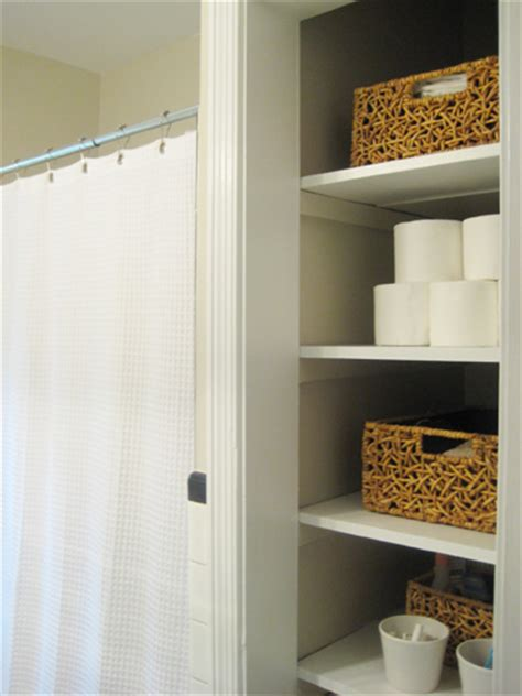 bathroom closet door ideas take the door your bathroom linen closet for a chic and open feeling