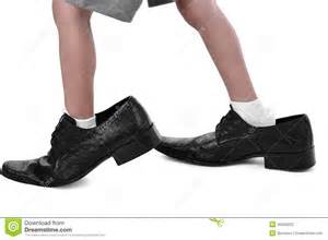 shoes for with big in a big shoes stock photo image 45056222