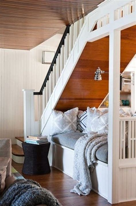like the cozy bed reading area and faucet curtain below the 11 best ways to use the space under your stairs the