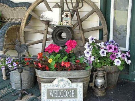 porch display with wagon wheel home decor