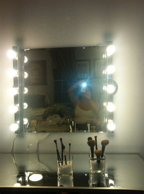 My diy hollywood girl inspired mirror and vanity light bar and mirror from ikea mirrored desk