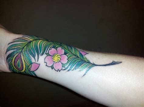 my new cover up tattoo on my wrist designed and inked by