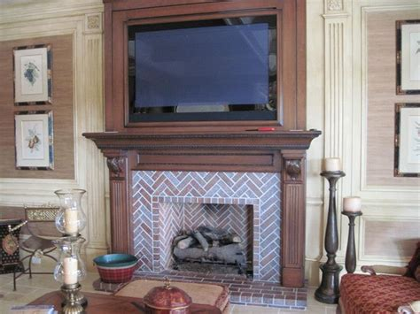 an isokern fireplace with herringbone brick pattern