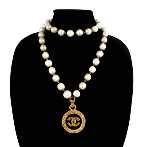 1993 chanel glass pearl necklace with cc logo drop at 1stdibs