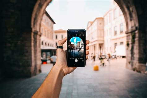 taking pictures person holding black android smartphone 183 free stock photo