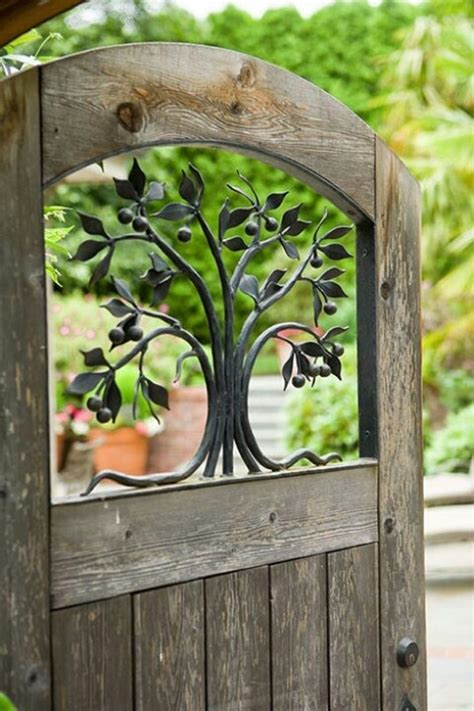 Backyard Gate Door by Wood Gate With Wrought Iron Tree Favorite Sculptures