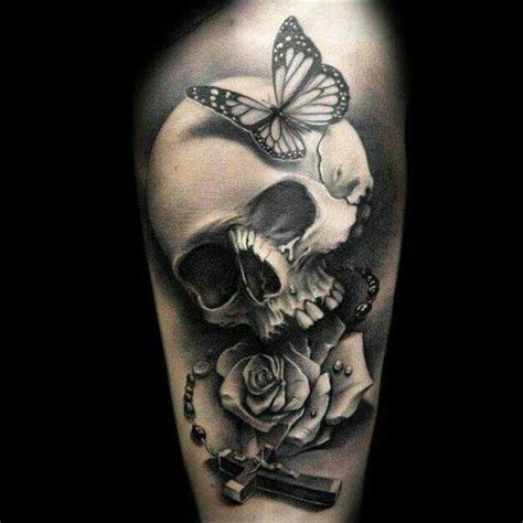 rosary skull with butterfly let your body be a canvas
