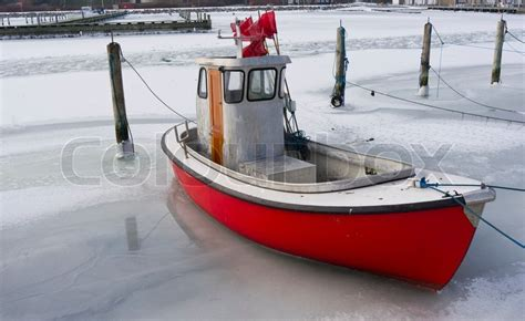 boat license denmark tiny fishing boat caught by the ice in the harbor of