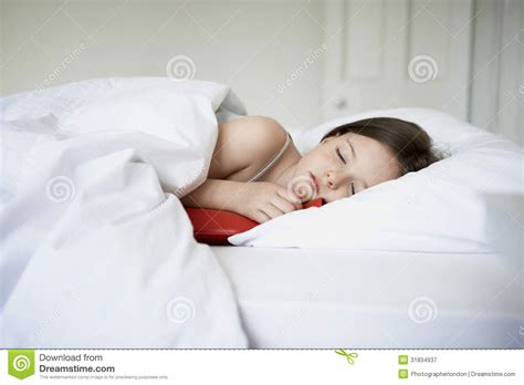 sexy girl in bed girl sleeping with hot water bottle in bed royalty free stock photography image