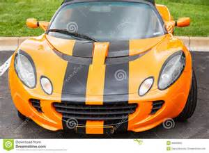 orange and black sports car in parking lot