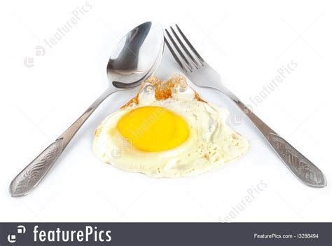 Fry Fries With Only One Spoon Of by Fried Egg With A Spoon And Fork Image