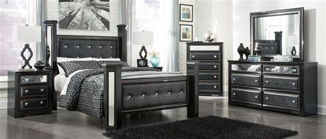ashley furniture black bedroom set ashley constellations 4 piece poster bedroom set in black
