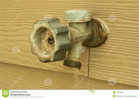 Leaking Outside Water Faucet by Outside Faucet Leaking And Wasting Water Stock Photography