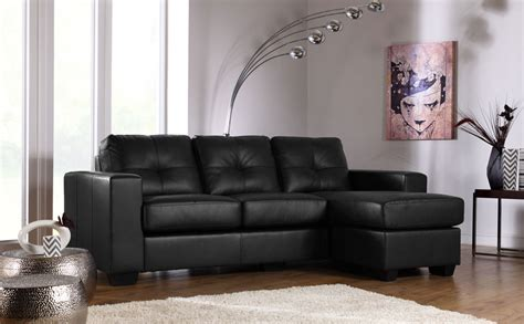 Astonishing black leather sofa idea with cozy feet rest design idea at captivating wooden
