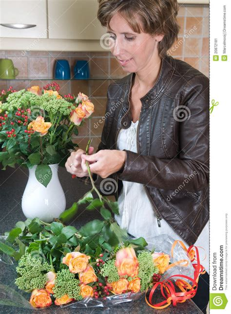 putting flowers in a vase stock image image 20872181