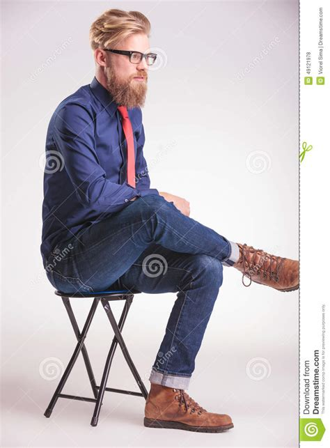 casual sitting on a stool stock photo image