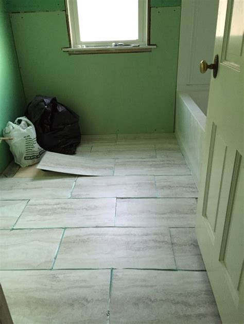 12x24 tile in small bathroom which direction should i lay the 12x24 vinyl tiles in our