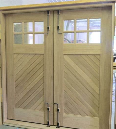 swing out carriage doors clingerman doors custom wood garage doors clearville pa