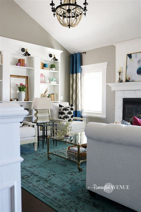 living room reveal this makes that bright white with a pop of color living room reveal
