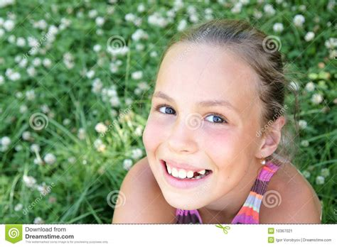 youth and beauty pretee preteen girl on clover stock image image 10367021