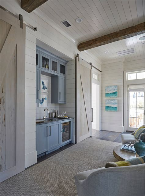 beach home bedroom with pecky cypress barn door on rails interior design ideas relating to beach house home bunch