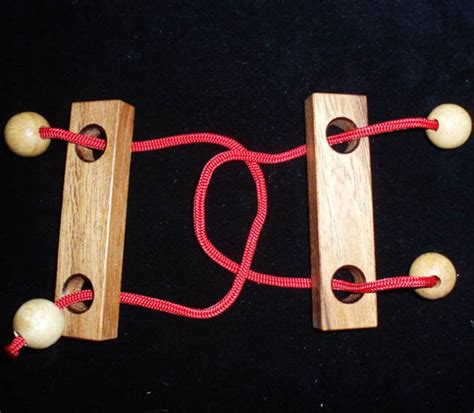Wood And String - trouble string puzzle brain teaser