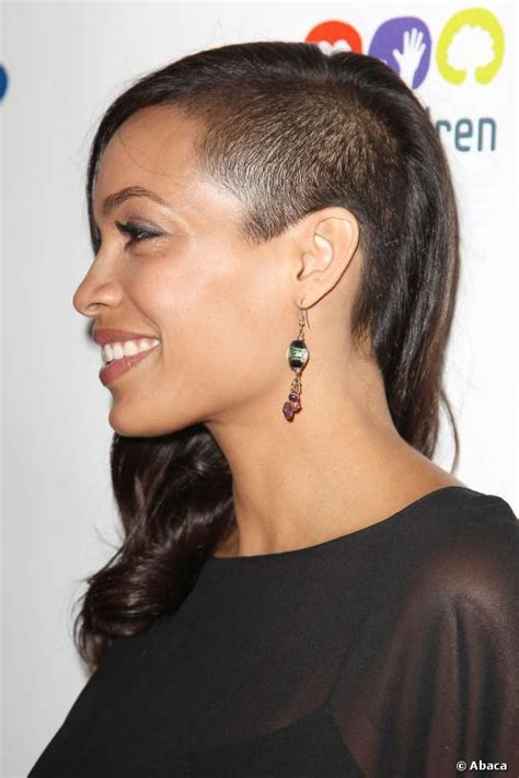 womens hairstyle covers half of her face rosario dawson shaves off half her hair considers going bald