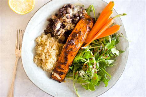 design love fest salmon burgers spicy cajun salmon bowl sprinkle of green