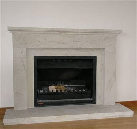 Classical Fireplace by Classical Linear Styling With Tuscan Moulding To Mantle