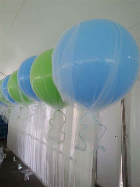 3' balloons with tulle and ribbon. Light blue and lime