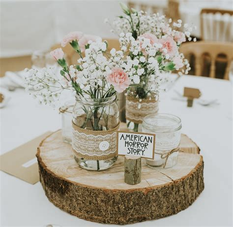 wedding centerpiece jam jars hessian lace on log slices