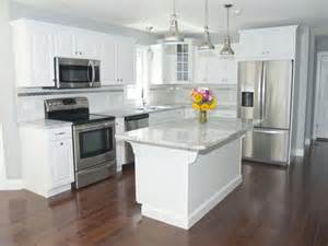 White Kitchen Cabinets With Stainless Steel Appliances A Well Pendant Lighting And Granite Counters On Pinterest