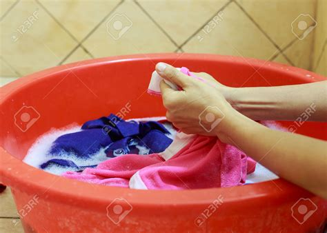 washing clothes by hand in bathtub hand laundry or machine laundry which do u prefer and why