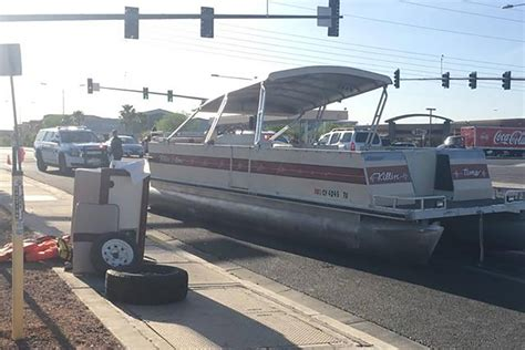 boat trailer wheel fell off pontoon boat falls off trailer lands on henderson street