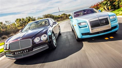 bentley vs rolls royce 2014 bentley flying spur vs 2014 rolls royce ghost head
