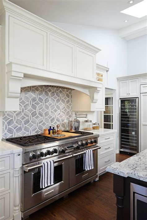 backsplashes for white kitchens geometric tile backsplash adds modern flair to white kitchen ideas
