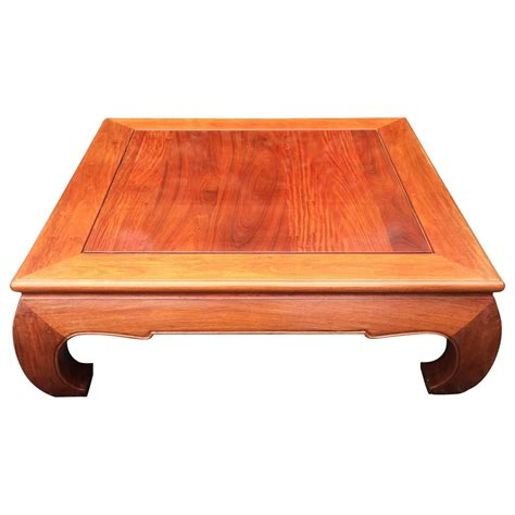 large handsome mahogany square coffee table with asian