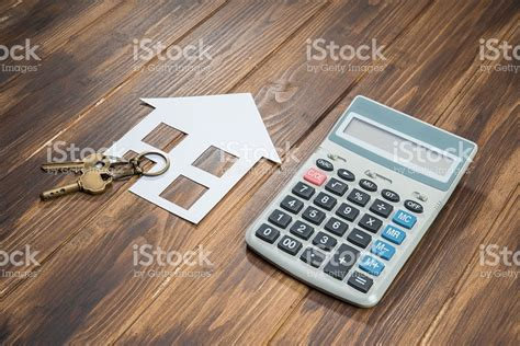 Apartment Building Calculator Mortgage Calculator House And Key With Calculator Stock