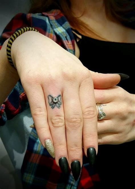 tattoo finger tips finger tattoos 101 designs types meanings aftercare