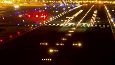 runway lights at tl ha ls airport runway at with glowing runway