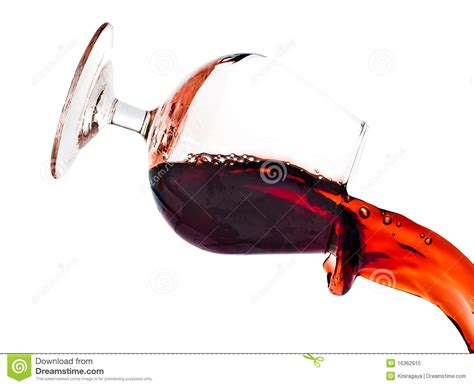 glass spilling red wine spilling from a transparent glass royalty free