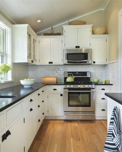 white kitchen cabinets black countertops pin by warner on home design stove