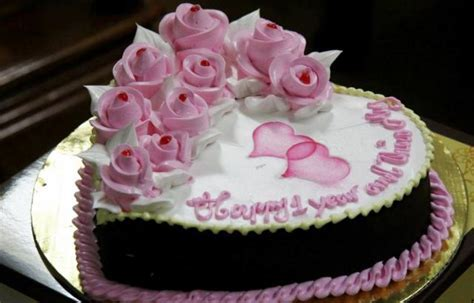 Heart Shaped First Anniversary Cake with Pink Pastry Roses