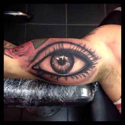 realistic eye tattoo assassins creed on leg by paul priestley