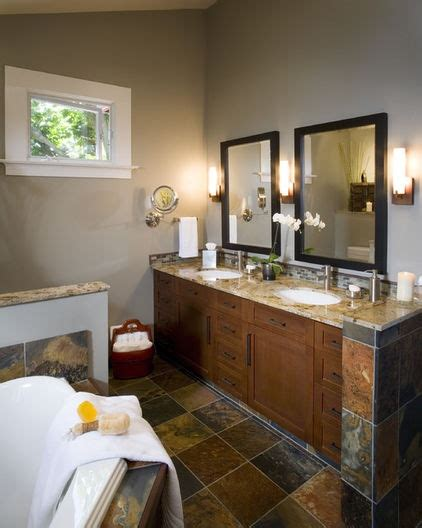 in this space greige walls up the warm tones of the slate tiles and completes the bathroom