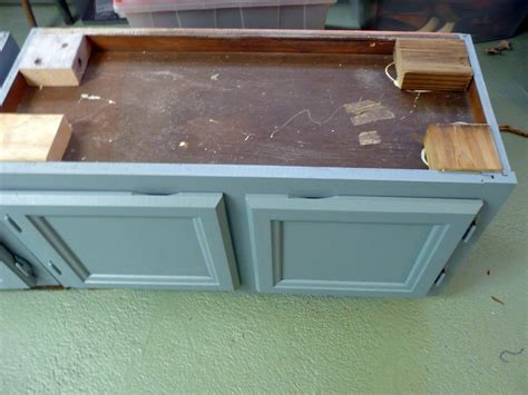 workbench out of kitchen cabinets upcycle kitchen cabinets into a storage bench how tos diy