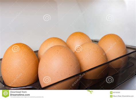 Shelf Of Refrigerated Eggs by Inside The Refrigerator Stock Photo Image 82732320
