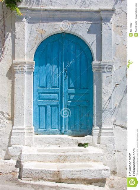 white stone house blue door on white stone house stock photo image 10373180