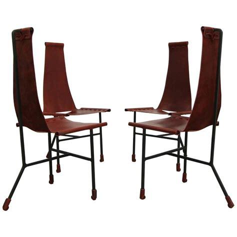 set of four custom latigo leather and steel dining chairs